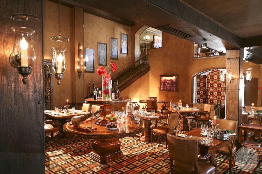 Hotel dining area with wood work and tiled floors