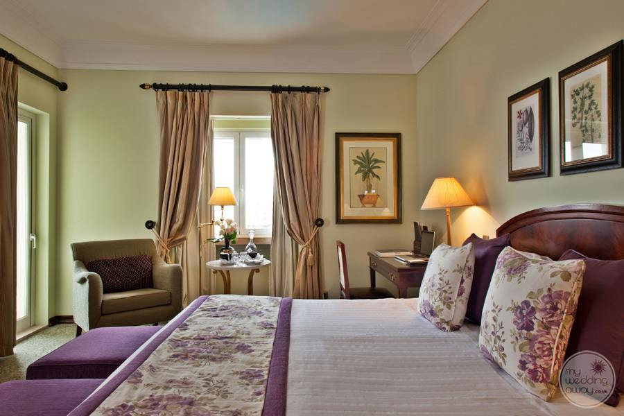 Palacio Estoril Hotel Mauve bedroom with seating