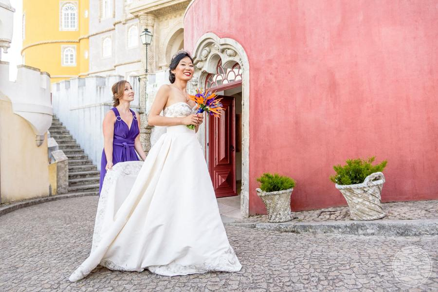 bride outside castle walking on cobblestone