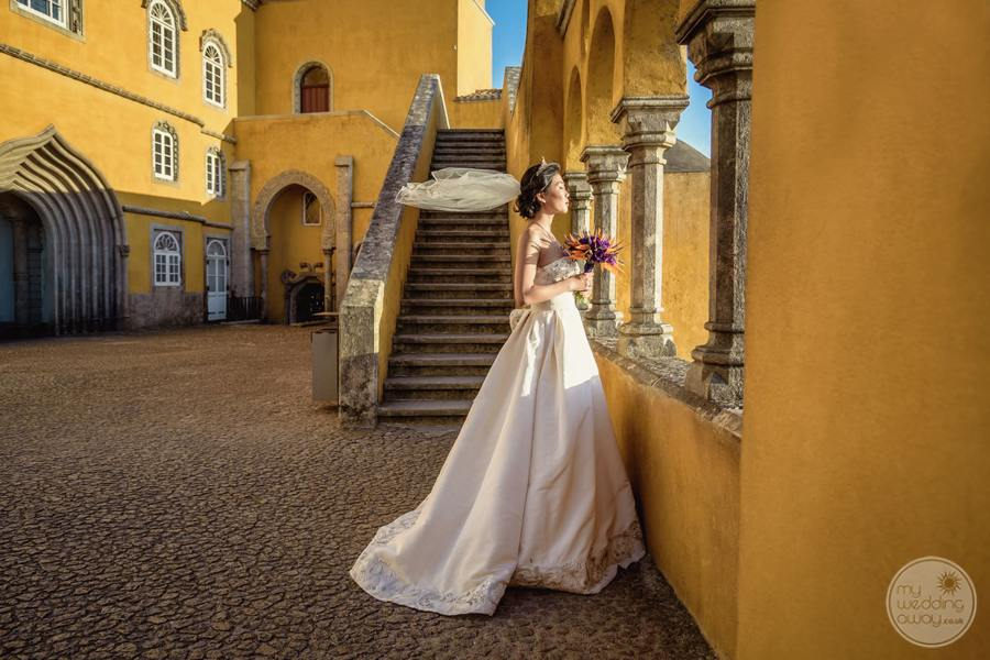 entrance to palace with bride standing by stairway