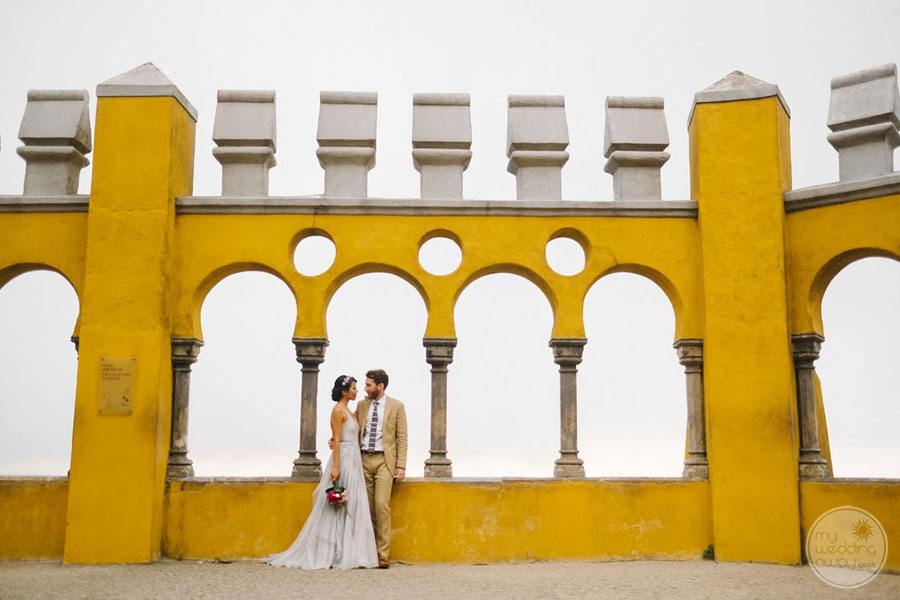 Pena Palace Wedding Couple taking photo by top exterior of building