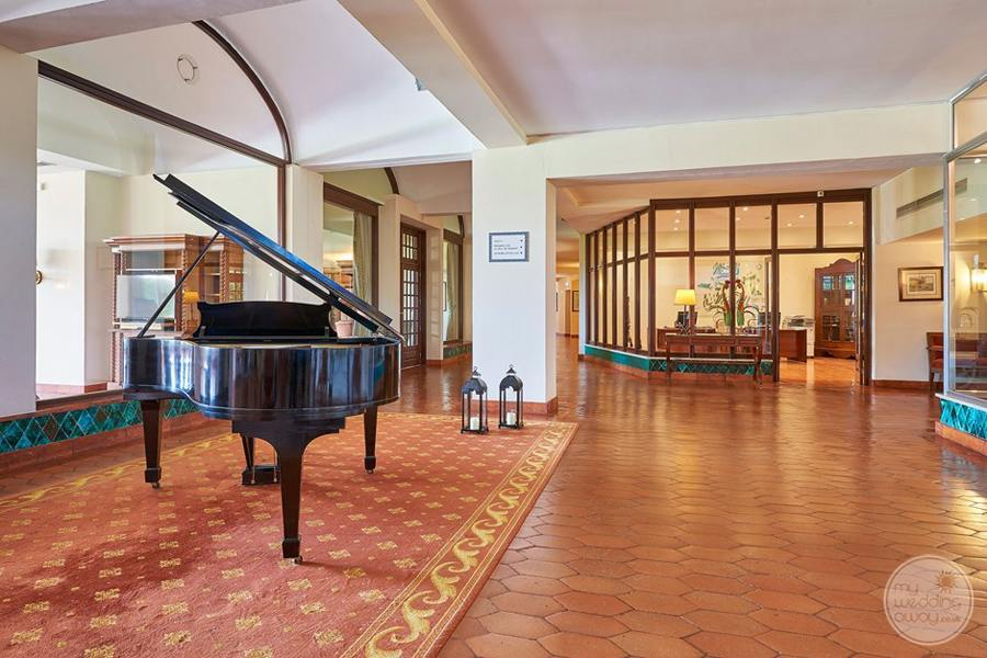 Lobby grand piano and walkway to shops