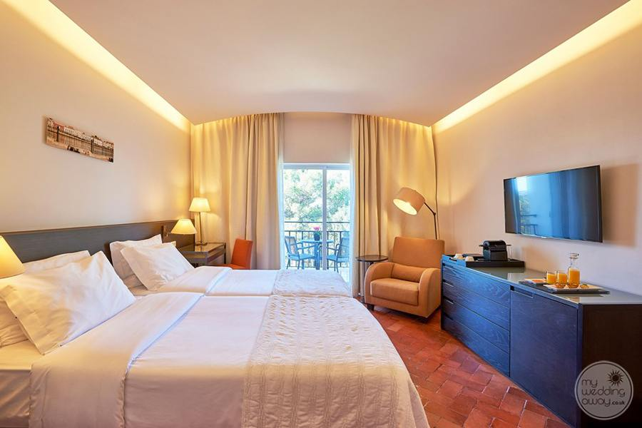 Penina Hotel and Golf Resort bedroomm with outside terrace