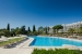 Penina-Hotel-and-Golf-Resort-pool-view-with-lounge-chairs