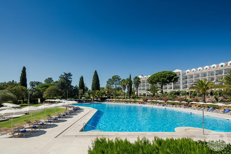Penina Hotel and Golf Resort pool with with lounge chairs