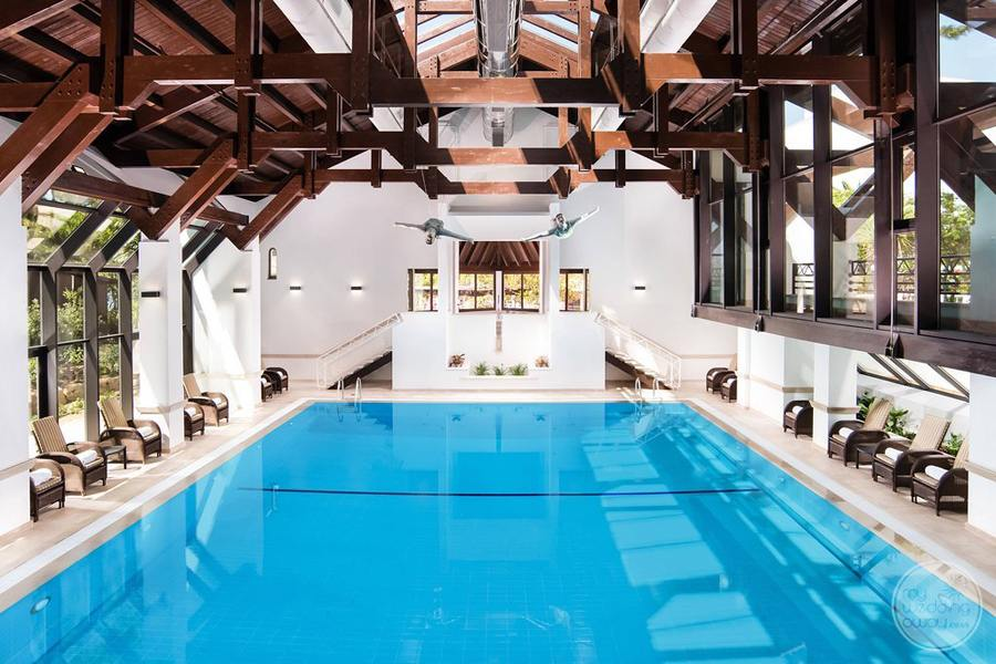 indoor swimming pool with chair seating