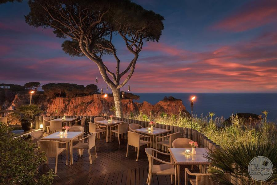 restaurant overlooking ocean in the evening at sunset