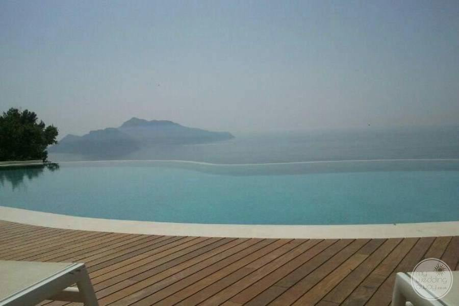 view of main infinity pool with surrounding ocean