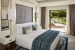 Tivoli-Carvoiero-Algarve-Resort-bedroom with-terrace-seating