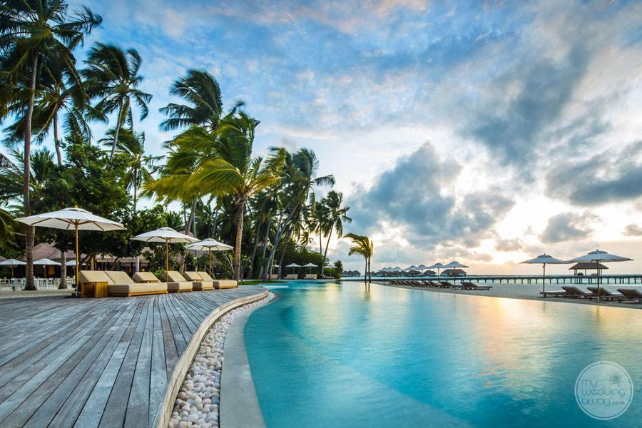 Beach Lounge Chairs beside infinity pool