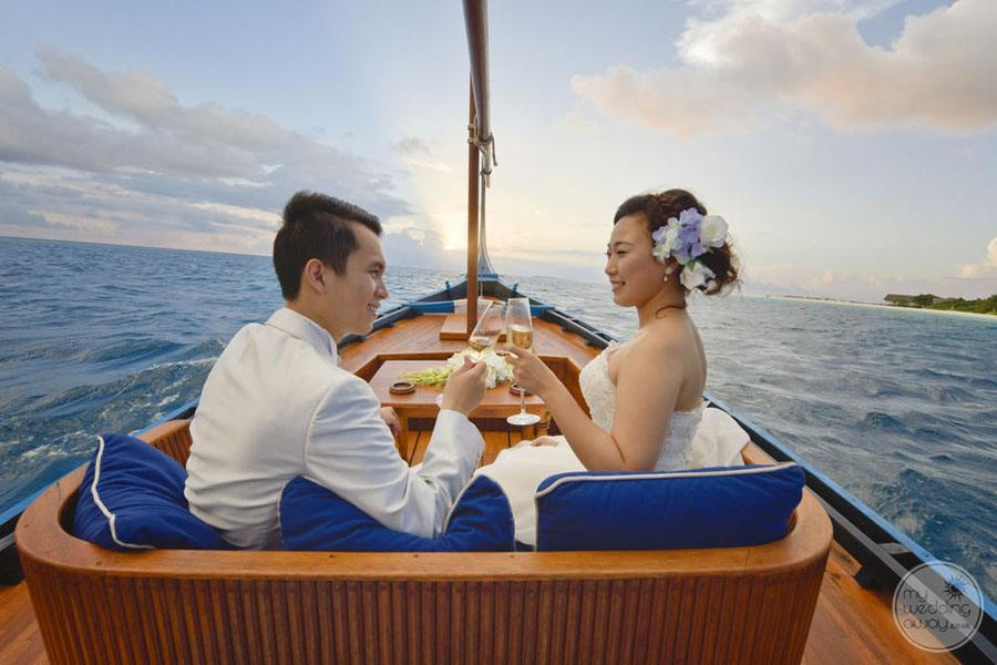 Four Season Maldives at Landaa Giraavaru Sailboat Wedding Couple
