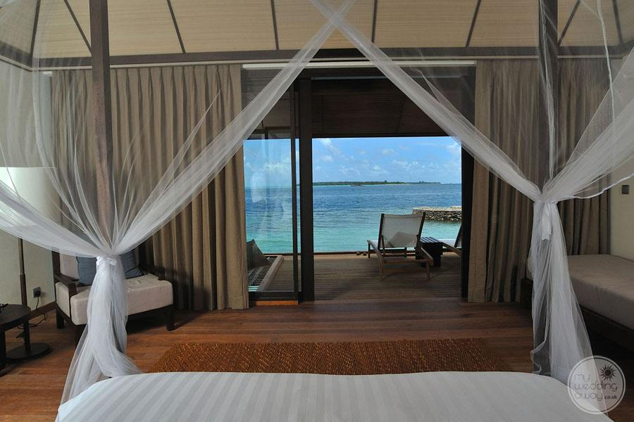 king bedroom with outer deck and view of ocean