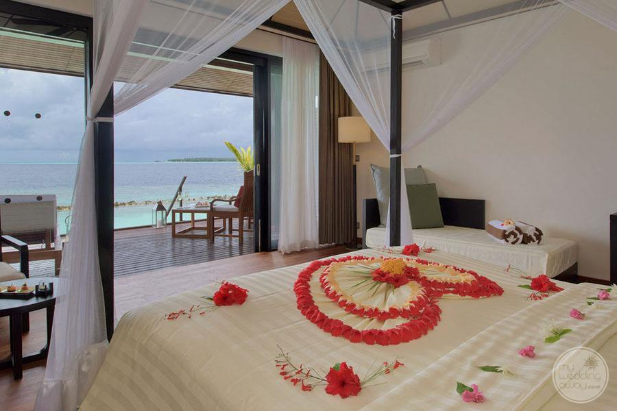 Lagoona Villa suite with flower petal decorated bed