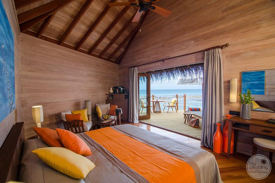 Resort Interior Bedroom with brown and orange decor