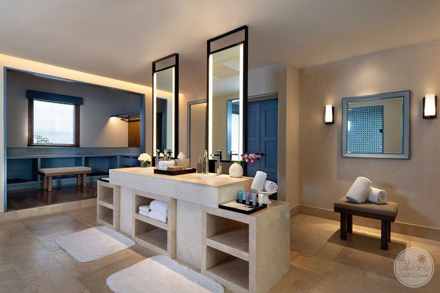 beach Villa Bathroom with double sinks and sitting area