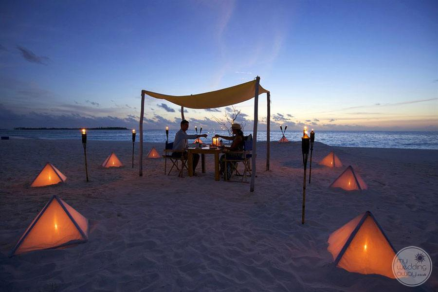 Beach at Night with couple having romantic dinner