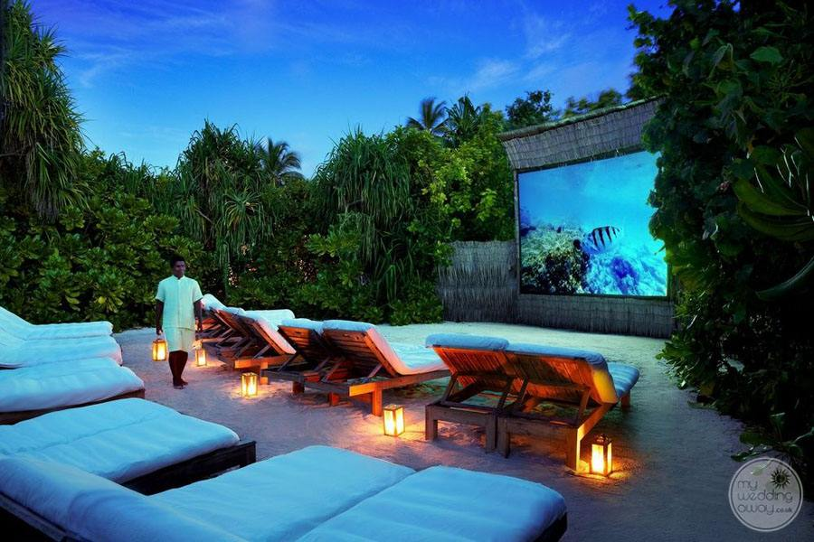 Outdoor Theatre with comfy lounge chairs and soft lighting