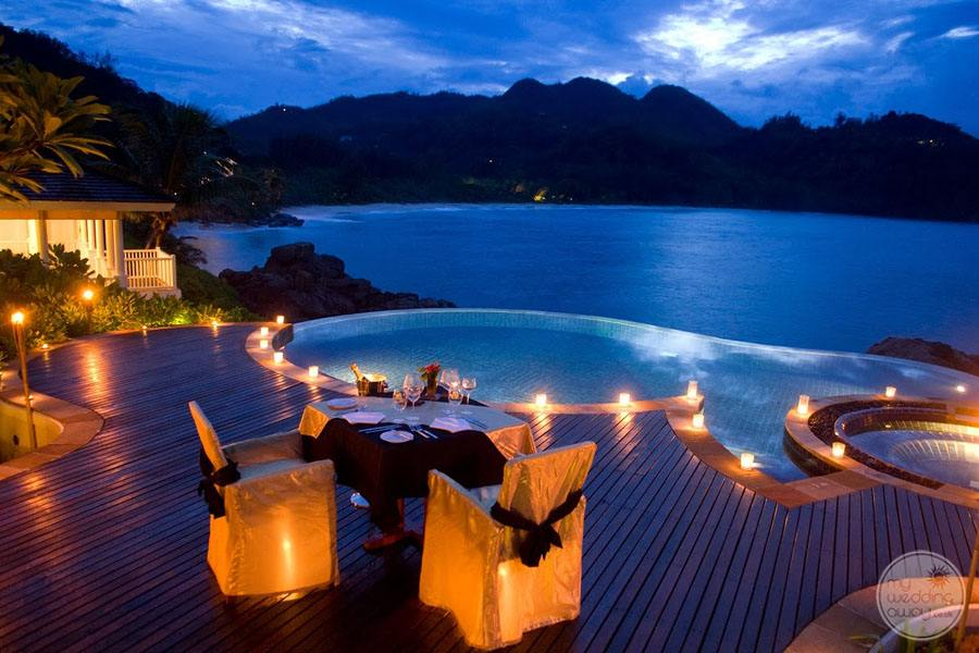 Deck with infinity pool Overlooking Ocean at night