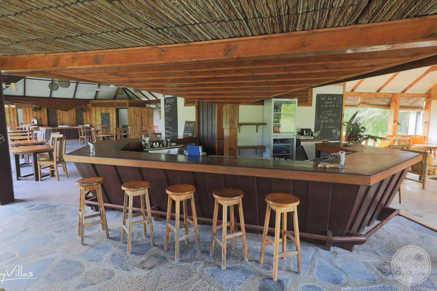 Bar Area with tables in wooden decor