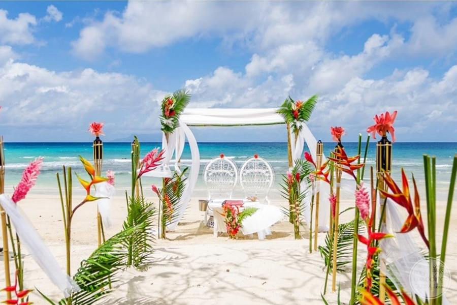 Ceremony Gazebo on the beach with floral design