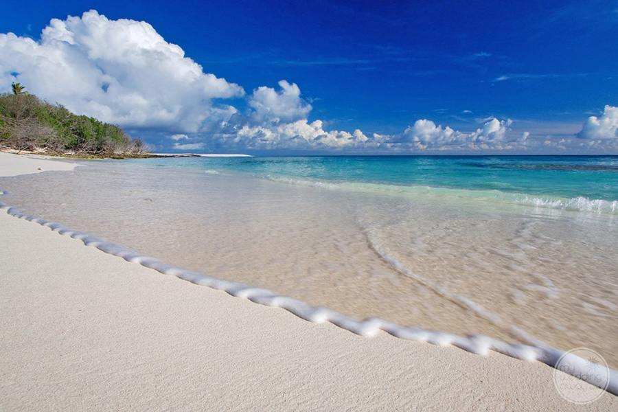 Beachfront with white sand and clear turquoise water