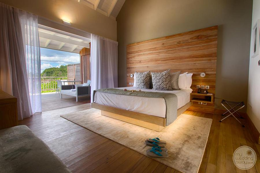 rustic Bedroom with solid wood headboard and garden view