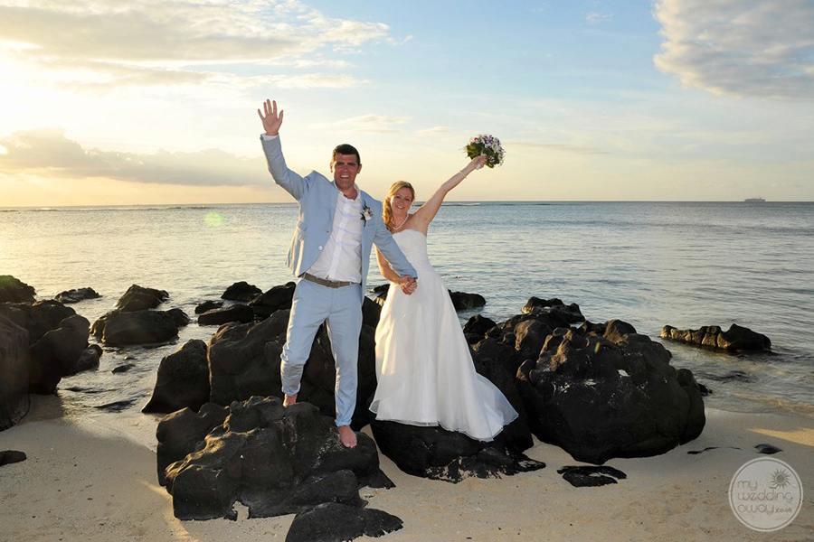 Wedding Couple on the beach taking photo