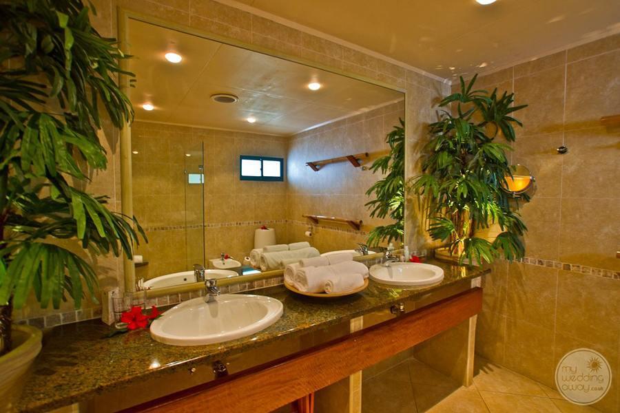Jr Suite Bathroom with double vanity sinks