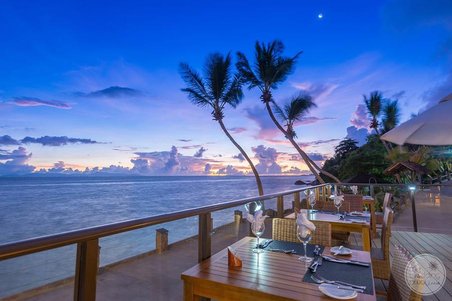 Outdoor Dining overlooking the ocean at sunset