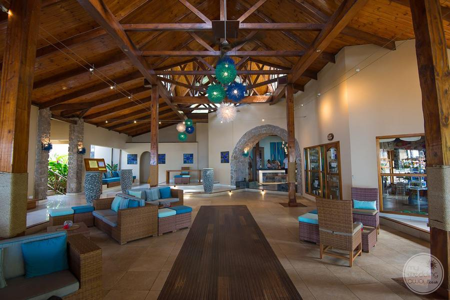 Hotel Lounge area decorated in lovely shades of blue with wood accents