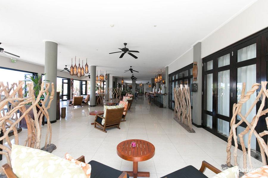 oceanview bar with surrounding lounge chairs and artful decor