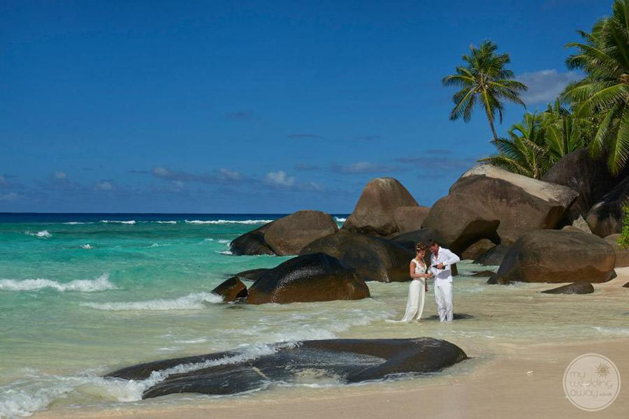 Hilton Seychelles Labriz Resort and Spa wedding couple on beach