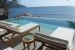 Hilton Seychelles-Northolme-Resort-and-Spa-deck-chairs-overlooking-infinity