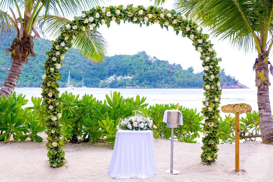 beach wedding gazebo with lush floral decor on beach