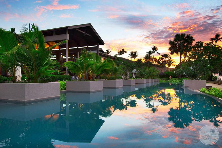 resort tropical koy fish pool at sunset