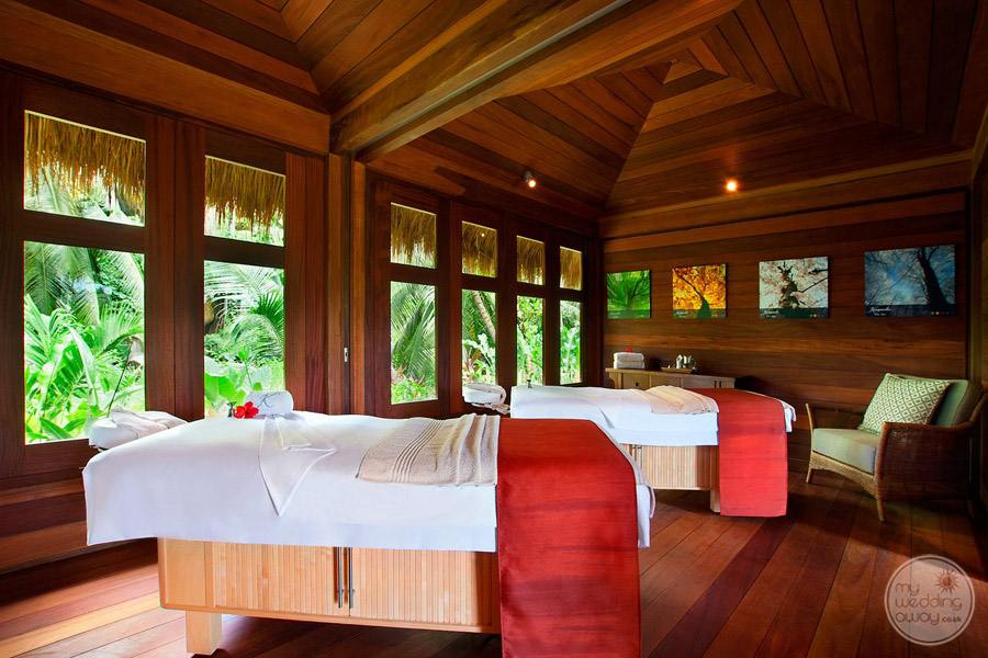 couples massage room with tropical view