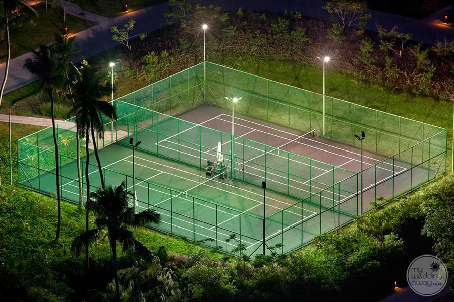 tennis courts on property with night lights