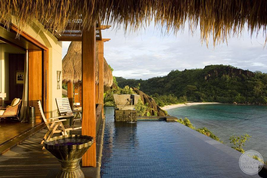 bedroom suite with infinity pool and oceanfront view