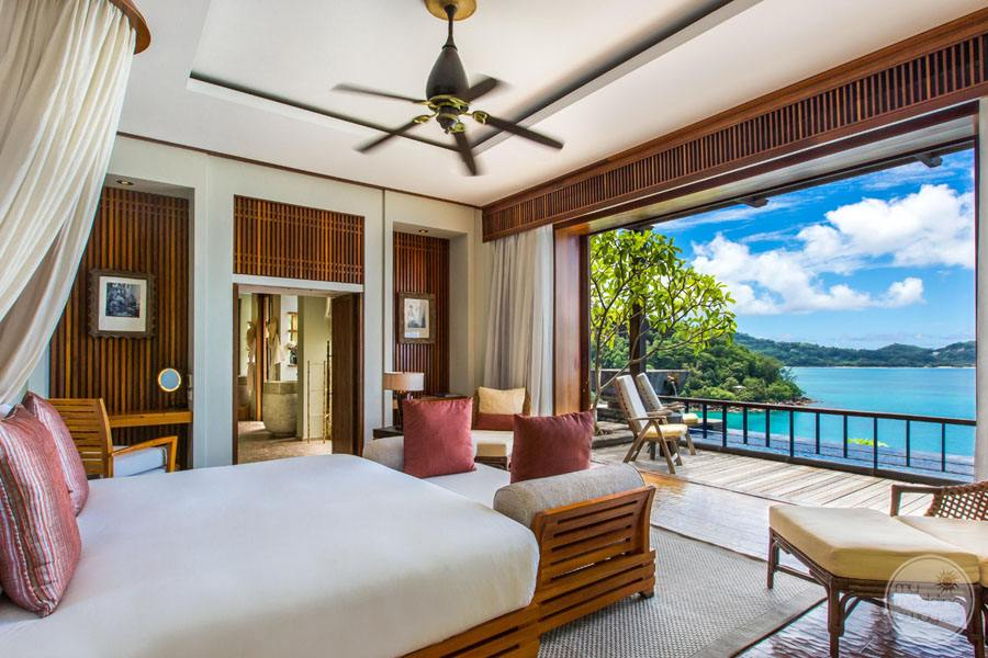 queen bedroom with view of mountains and ocean