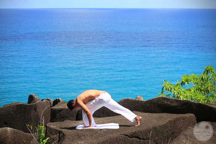 yoga session by the ocean on cliff