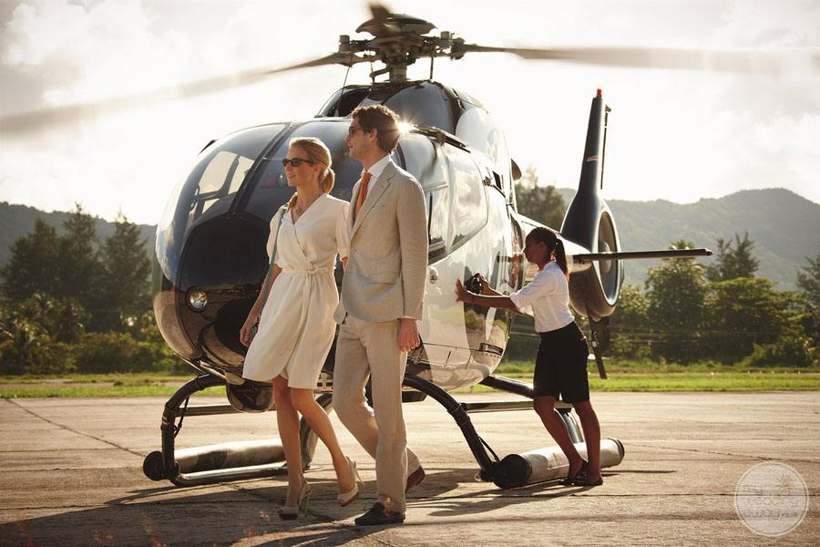 helicopter arrival of couple