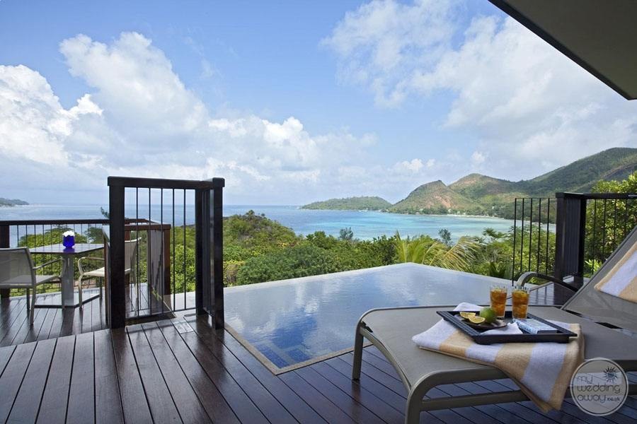ocean view pool villa with deck chair