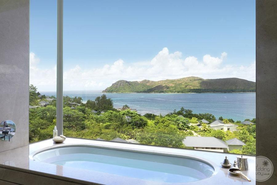 Raffles Seychelles Resort panoramic pool villa view bathtub