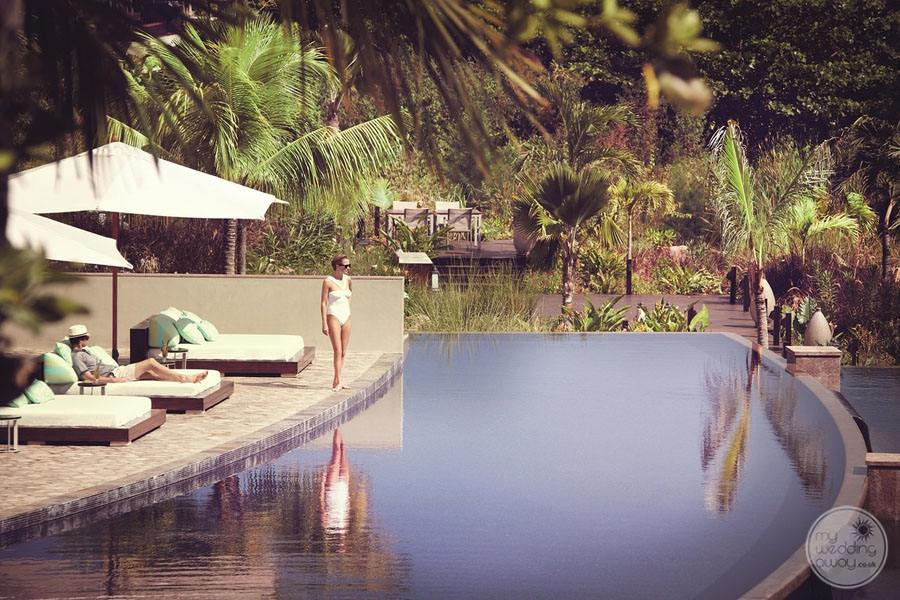 outdoor infinity pool with resort guest