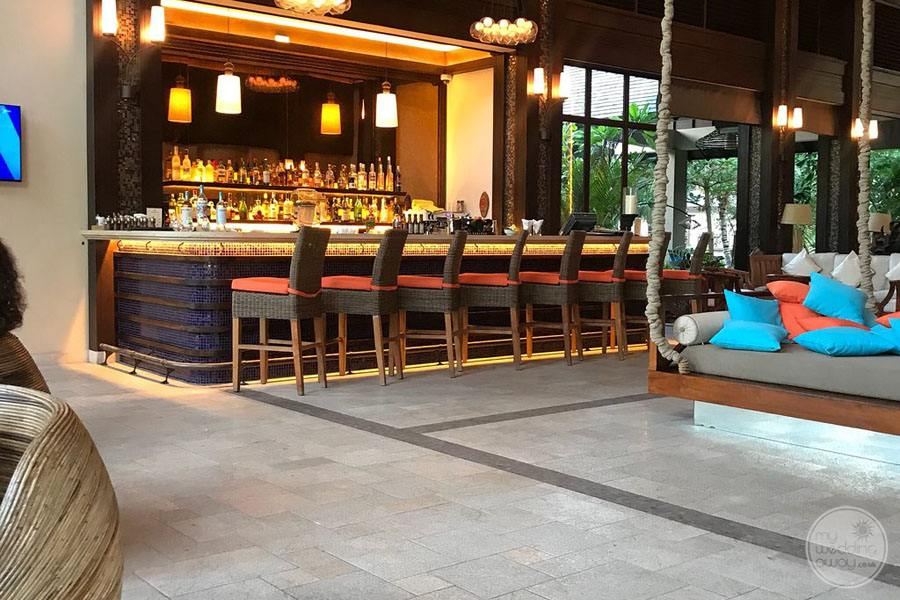 The hotel bar with additional seating nearby