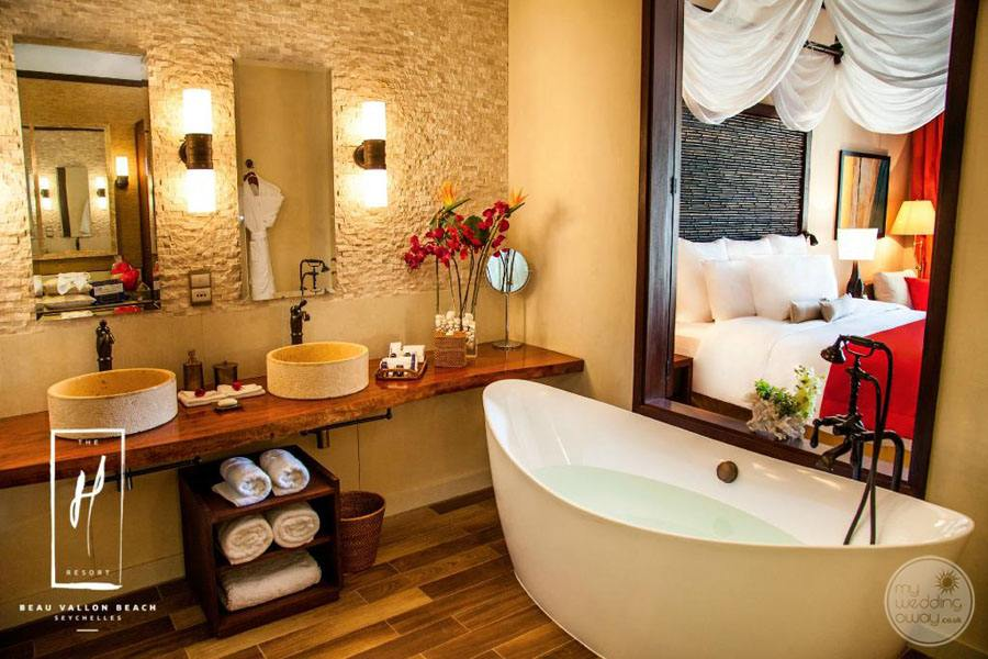 main bathroom bathtub with double sinks