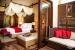 The-H-Resort-Beau-Vallon-Beach-bedroom-lounge-area