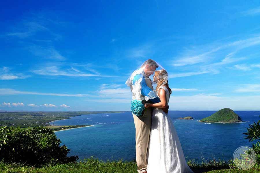 Wedding Couple taking picture overlooking the Ocean