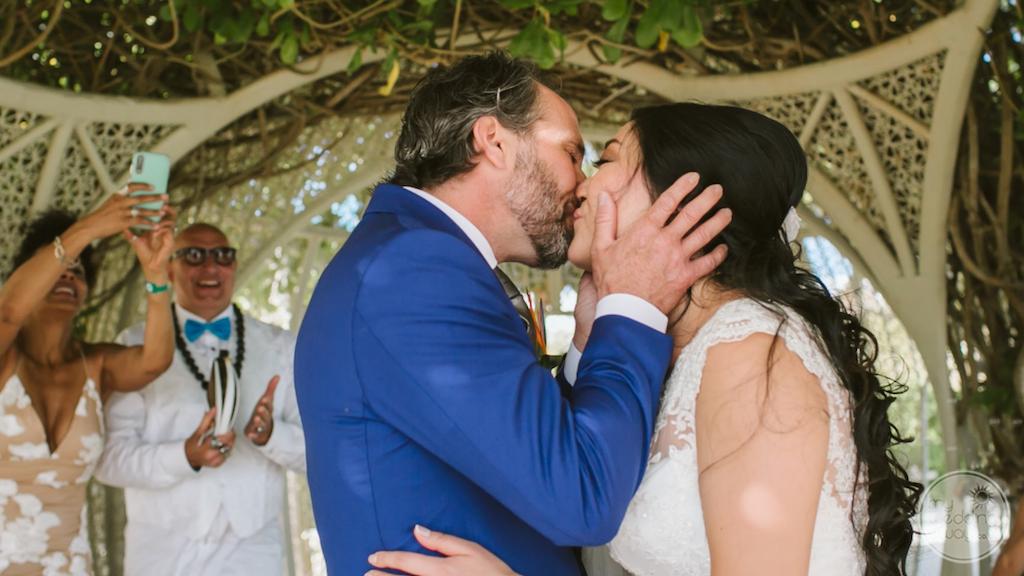 destination wedding ceremony bride and groom kiss