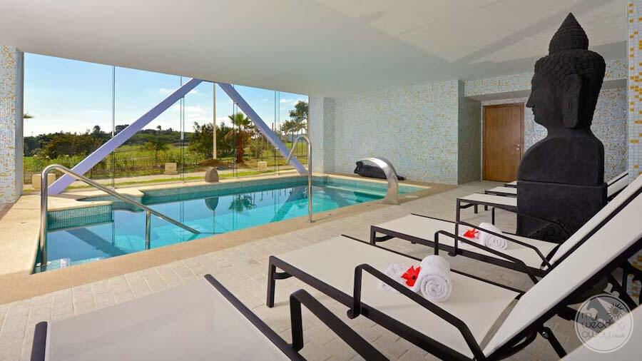 indoors in the spa with plunge poollounge seating and a view of the gardens